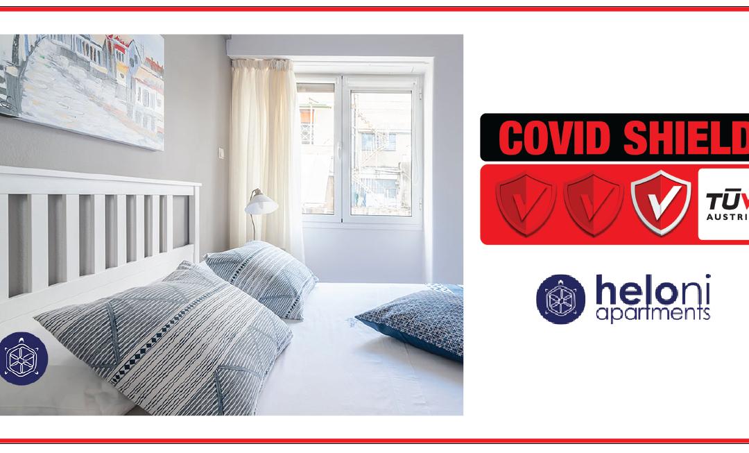 """Η Heloni Apartments πιστοποιήθηκε με το Ιδιωτικό Σχήμα Πιστοποίησης TÜV AUSTRIA CoVid Shield, με το επίπεδο """"Principal""""."""